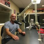 Husam Hishmeh talks with financial planner Michael Anderson